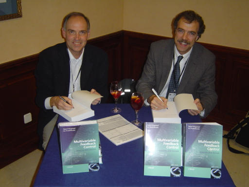 [Sigurd Skogestad and Ian Postlethwaite sihning their book in Sevilla, Spain in December 2005]